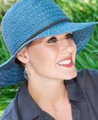 hat accessorizing with earrings