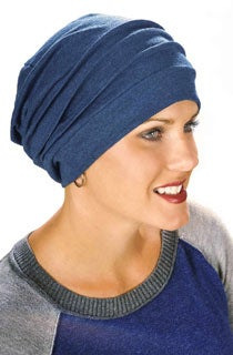 blue slouchy cotton hat worn on a cancer patient